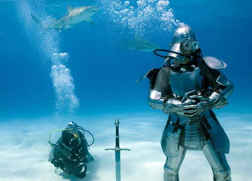 Adam Savage wearing armor underwater