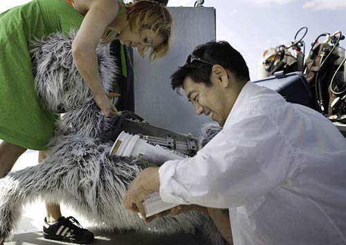 Grant Imahara working on dog