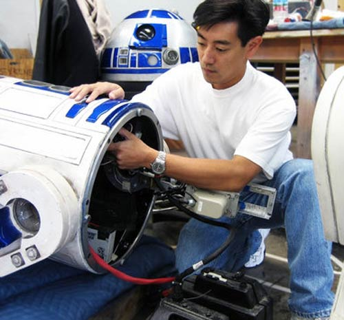 Grant Imahara working on R2-D2