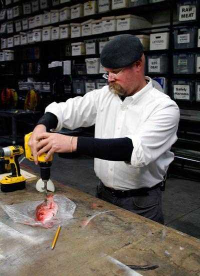 Jamie Hyneman drilling into a fish